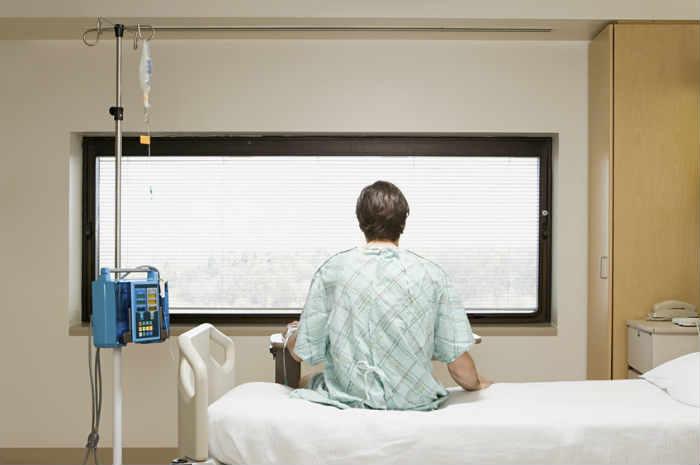 Posizionamento del paziente seduto a letto