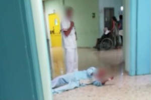 Paziente a terra in video shock, l'azienda: Tutto falso
